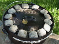 Ringed charcoal placement on a Dutch oven